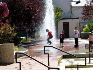 Kids Playing in a Fountain
