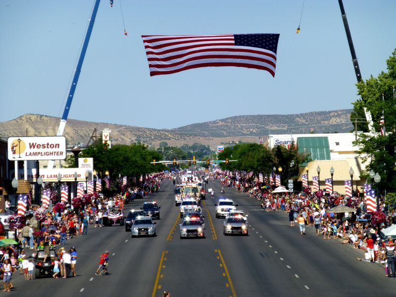 American Flag Flying Over a Parade