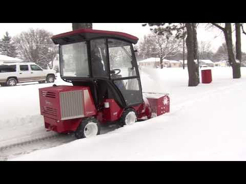 Snow Machine Clearing a Sidewalk